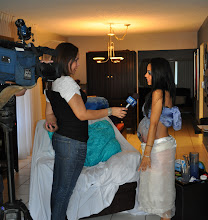 Photo: Telemundo 51 Asks some questions to our model after the Pregnant Belly Art Design is finnished.
