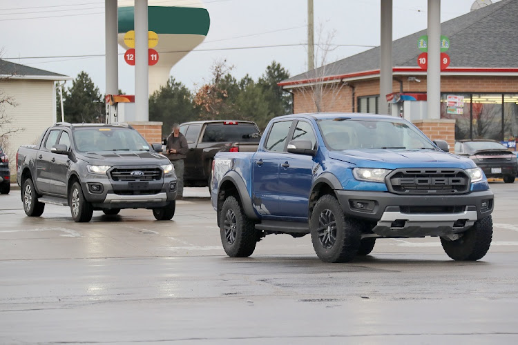 The 2019 Ford Ranger will see a number of minor styling changes. Here our spies spotted the Ranger Wildtrack (left) and Raptor. Picture: QUICKPIC