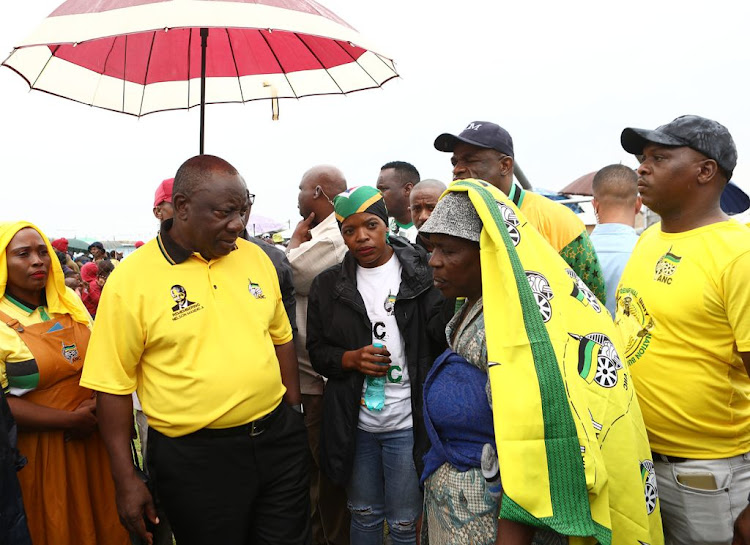 President Cyril Ramaphosa and Cosatu president Zingiswa Losi listen to Bulawa Nxamashe talk about a lack of service from the municipality during a door-to-door walk about in Pampierstad, Northern Cape, on January 7 2020 ahead of the ANC 108 birthday celebrations.