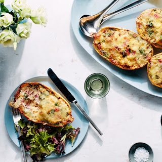 Cheesy Baked Spaghetti Squash Boats With Salami, Sundried Tomatoes, and Spinach.
