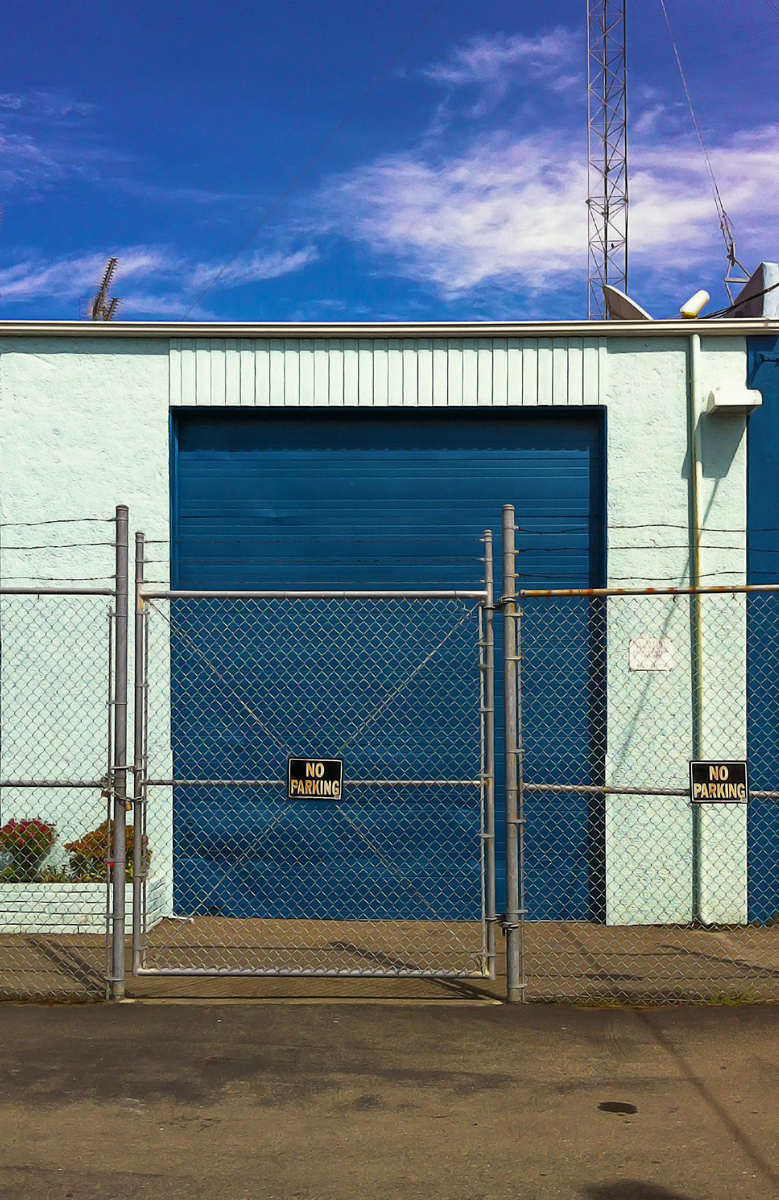 Photo: What's Behind The Blue Door? For that matter, why is there so much fencing and barbed wire?  Blue doors!  #UrbanSnap +Urban Snap