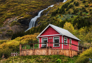 """Photo: Little Elves, Little Waterfall  Going into one of the valleys by Isafjordur takes you to many little homes near waterfalls.  I thought this one was quite lovely.  And if you look to the left there, you'll see the tiny homes they also built for the elves.  I was editing this photo at dinner one evening in Isafjordur.  One of the waitresses saw this house, recognized it, and said, """"Oh that's jklasdj(jkasdj^dhsaj"""".  Of course, I am doing my best to approximate the Icelandic language there...  from the blog at www.stuckincustoms.com"""
