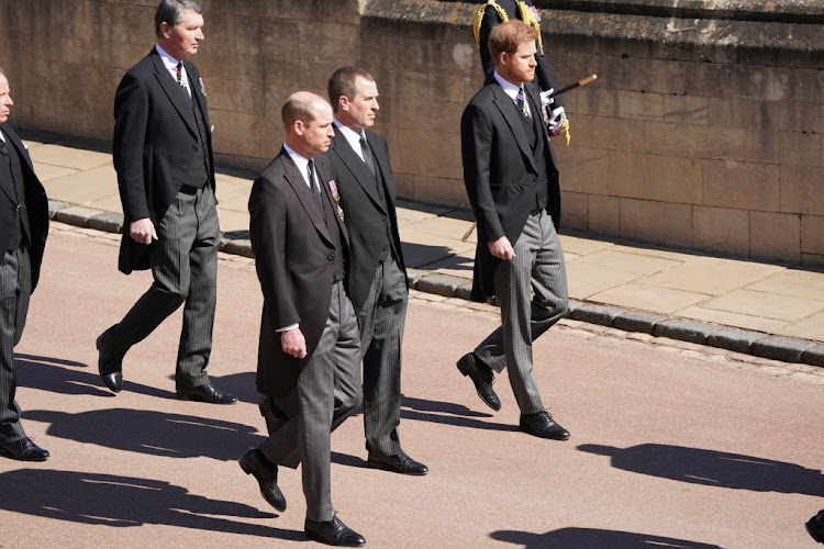 Princes William and Harry (Prince Charles' sons) and Peter Phillips (Princess Anne's son) walk behind their grandfather, Prince Philip's, coffin at his funeral.
