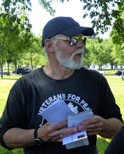 Photo: Veterans For Peace poet laureate Doug Rawlings hands out the letters