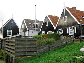 Photo: Houses were almost all black or green. This is traditional, dating back to when this was just a poor fishing village, and they couldn't afford to repaint their houses often, which living in sea air requires. So they used local grasses, which were plentiful, to make a green paint, or used tar, which sealed the wood, which made houses black.