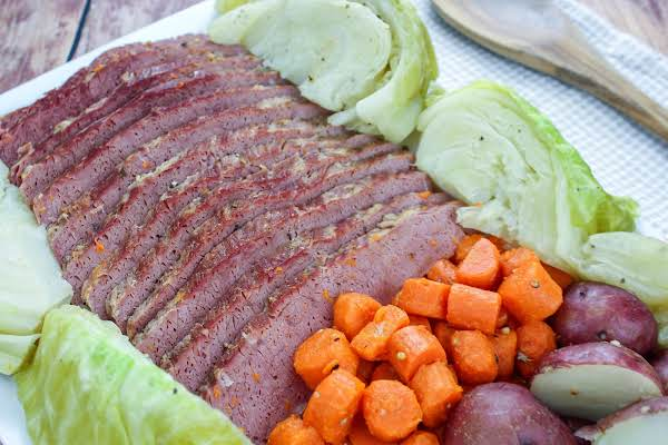 Corned Beef & Cabbage On A Platter With Carrots And Potatoes.