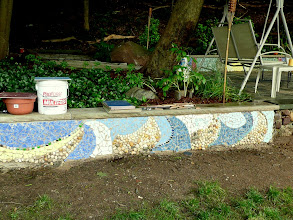 Photo: Mosaics walls are now surrounded by ivy, peonies, decorative grass, hostas, rhododendrons, lilies and petunias