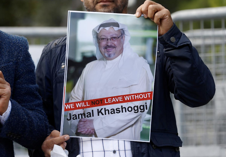 A demonstrator holds a picture of Saudi journalist Jamal Khashoggi in Istanbul, Turkey. REUTERS/Osman Orsal