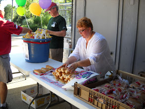 Photo: Janice Rumbaugh helped out with the buns. Bob Gregory provided free chips.
