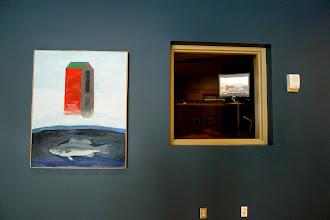 Photo: Joyce's work hanging next to an underwater fish video!