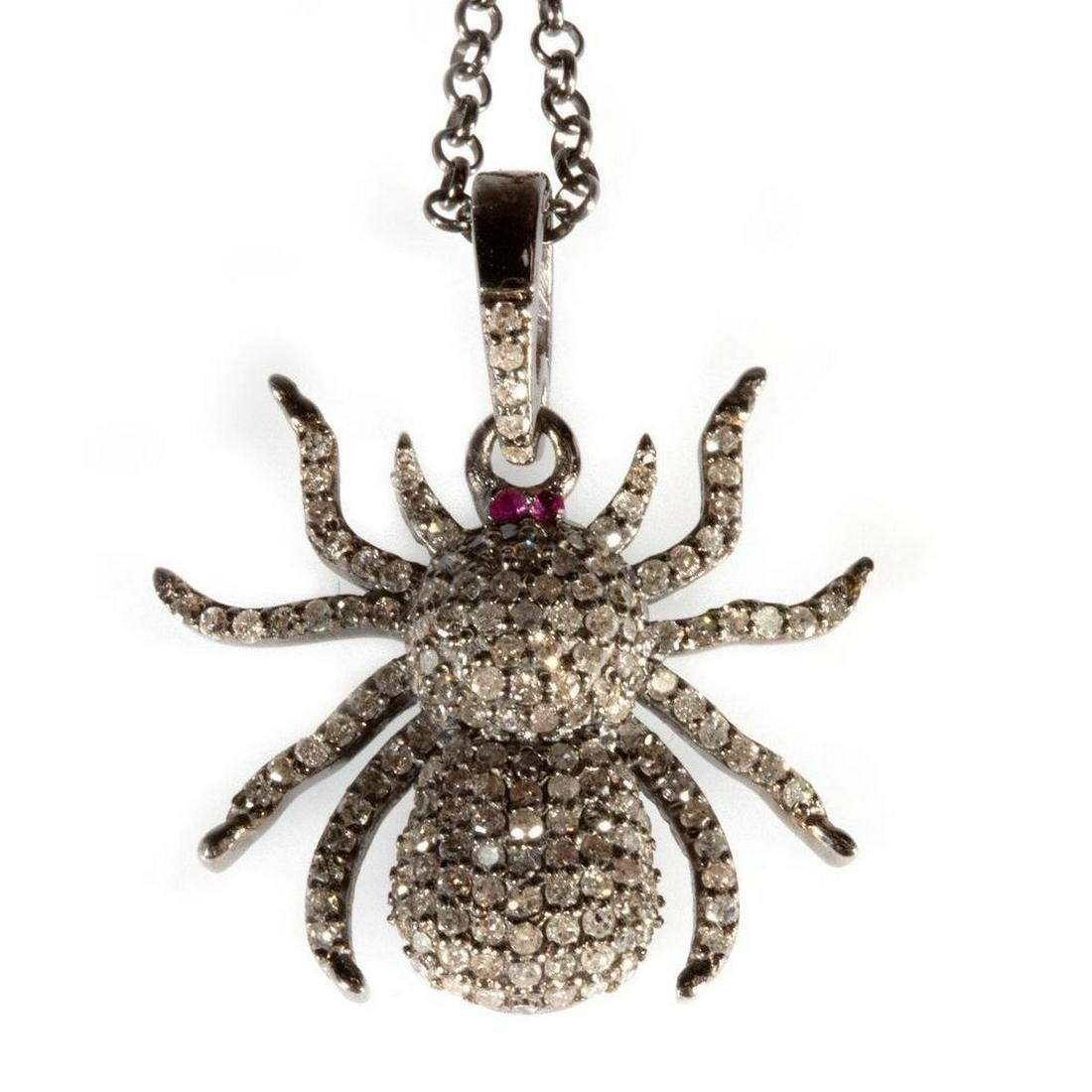 Diamond, ruby and blackened silver pendant and chain