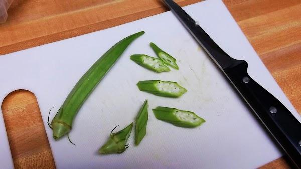 Wash & dry okra; cut off stem & blossom ends; slice diagonally into ovals...