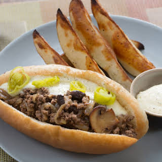 Italian Beef Grinders with Aged Cheddar Cheese Sauce & Crispy Potato Wedges.