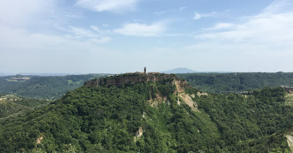 Photo: Civita in the distance. The only entrance is the pedestrian bridge on the right.