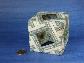 Photo: Model: Decoration Box Modular Cube;  Creator: Bennett Arnstein;  Folder: William Sattler;  12 dollars total;  Publication: Modular Origami Polyhedra (Bennett Arnstein, Rona Gurkewitz, Lewis Simon) ISBN 0-486-40476-5