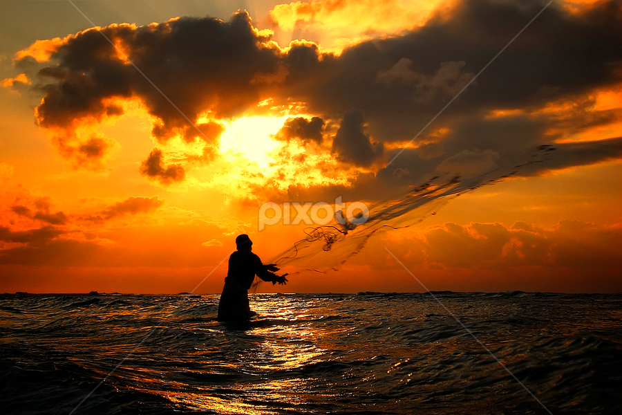 Brave Fisherman by Bigg Shangkhala - People Street & Candids ( bali, pwcsilhouettemotion, silhouette, fish, cloud, candid, nets, sunrise, beach, fisherman )
