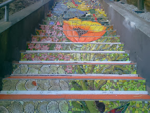 Photo: Fifth full day of work: detail from fourth flight of steps (from bottom) of the Hidden Garden Steps (16th Avenue, between Kirkham and Lawton streets in San Francisco's Inner Sunset District) as KZ Tile workers finished installing more than 80 pieces of the 148-step ceramic-tile mosaic designed and created by project artists Aileen Barr and Colette Crutcher. For more information about this volunteer-driven community-based project supported by the San Francisco Parks Alliance, the San Francisco Department of Public Works Street Parks Program, and hundreds of individual donors, please visit our website at http://hiddengardensteps.org.