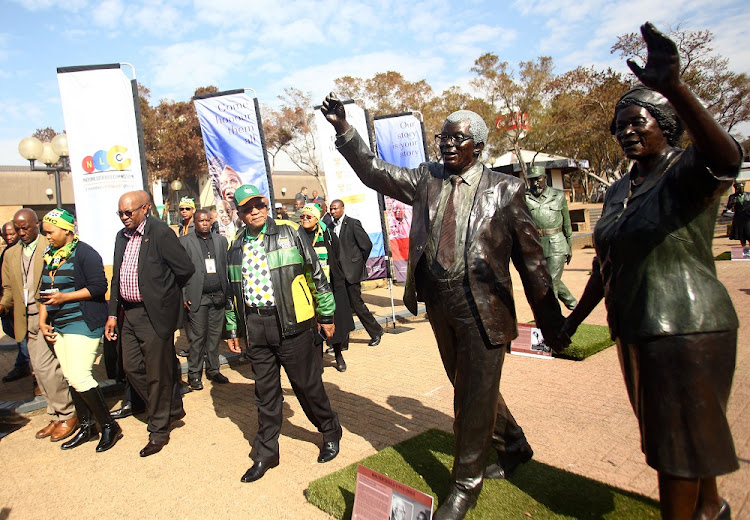 ANC President, Jacob Zuma looks at the lifesize statue of Walter Sisulu and Albertina Sisulu during his walkabout at the ANC Policy Conference held at Nasrec.