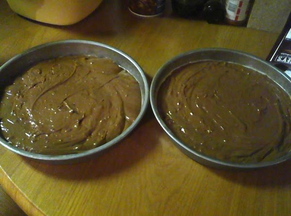 Make your 2 cake mixes and bake 4 round cakes 8 or 9 inch...