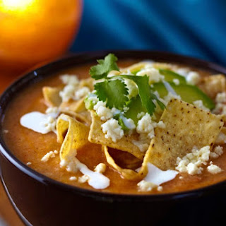 Savory Tortilla Soup with Crispy Tortillas, Queso Fresco & Crema Recipe