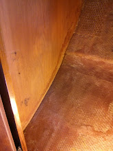 Photo: lower section of starboard bulkhead separating salon and vee berth cleaned in prep for tabbing.