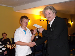 Photo: Adam Burroughs receives the 2009-10 Wiltshire Minor Individual Championship Trophy (and cheque) from Peter Richmond.