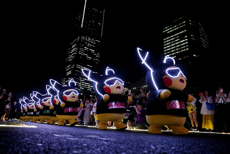 Performers wearing Pokemon character Pikachu costumes take part in a night parade in Yokohama, Japan.
