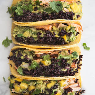 Blackened Salmon Tacos with Forbidden Rice & Mango Guacamole.