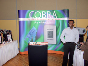"Photo: Imtee Baksh of Regulvar shows off their ""Cobra"" networking system"