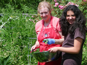 Photo: Mari and Alexa collecting salad from the garden