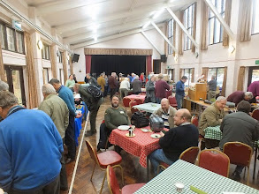 Photo: 003 Overall view of the hall not long after opening time. Nearest table features Julian Evison and Simon Hargraves (Spitfire Goggles to those on NGRM-Online) facing and David Gander, 009 Society Chairman in the dark jumper .