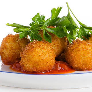 Cod Fritters with Spicy Tomato Sauce.
