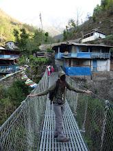 Photo: Emily crossing a bridge in Tikhedhunga (1540m)