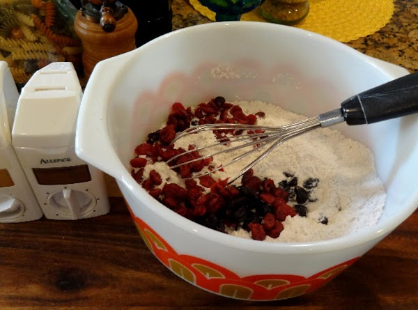 In a large mixing bowl, mix the dry ingredients together: flour, sugar, baking soda,...