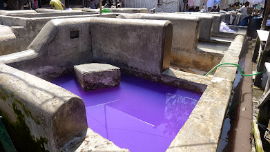 """Photo: These pools are used to clean laundry; the """"flogging stone"""" -- as they call it -- is used to beat laundry against and scrub off dirt/etc."""