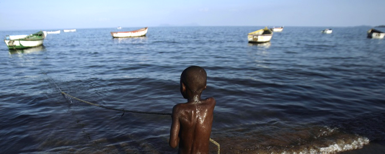 A boy swims in Lake Malawi. Both Tanzania and Malawi claim  sovereign rights over the eastern half of the northern part of the lake separating them. Picture: REUTERS/SIPHIWE SIBEKO