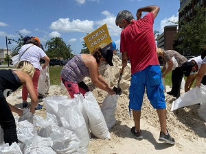 Residents fill and collect sand bags before the expected arrival of Hurricane Isaias in Doral, Florida, US July 31, 2020.