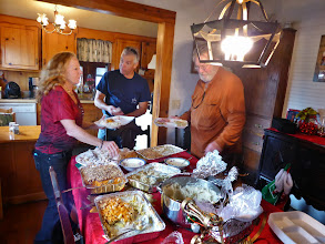Photo: Jim chatting with Ginger's sister Kacey - there was still lots of food in the kitchen (two turkeys and all the trimmings!)