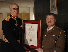 Photo: Major General MD Wood CBE presents the parchment to Warrant Officer Class 1 Shaun Collins.A presentation of the parchment that is officially awarded to Warrant Officer Class 1 (WO1) ranks within the Royal Logistic Corps that gives them the official appointment to 'The Honourable and Ancient Appointment of Conductors'. The parchments were presented by Major General MD Wood CBE.