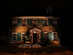 Photo: Brick home with Christmas wreaths snow and lights