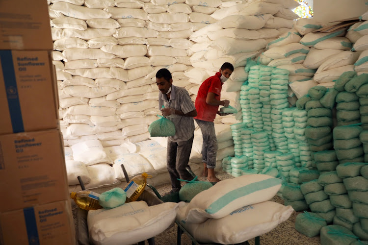 Workers prepare foodstuff for beneficiaries at a food distribution center supported by the World Food Program in Sanaa, Yemen June 3, 2020. File Photo