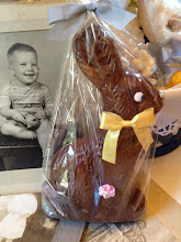 Photo: Here's the chocolate bunny AFTER.  By simple re-wrapping it in clear cellophane and adding a pretty bow, it looks like it came from a fancy candy store!