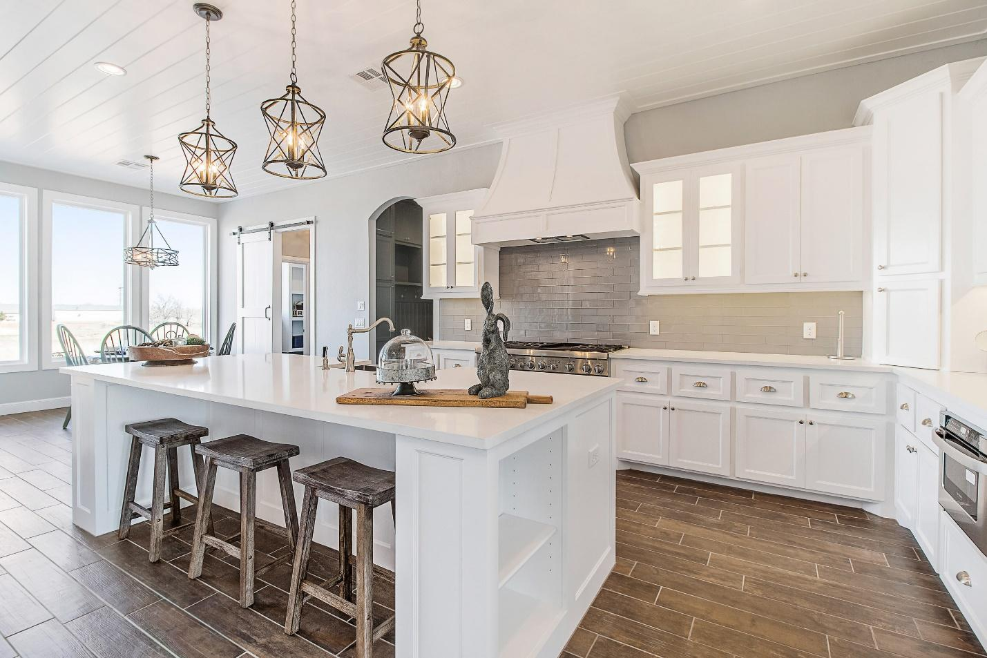Luxury kitchen interior, farmhouse barstools and rustic light fixtures