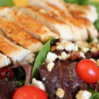 Grilled Chicken Salad w/ Goat Cheese, Dried Cranberries, Candied Walnuts.