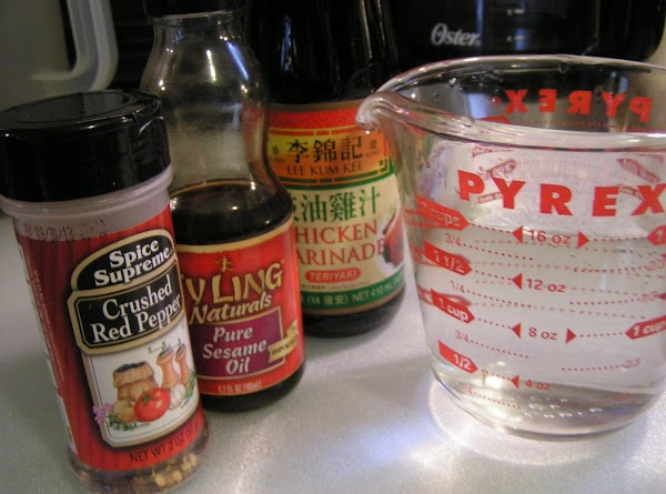 Over a medium heat and in a large pot combine marinade, water, sugar, oil,...