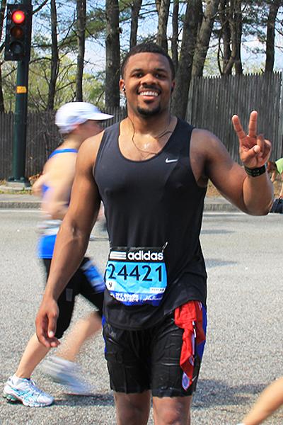 Photo: Sherwyn Rocke, a member of the Newton-Wellesley Marathon team, stopped by mile 17.