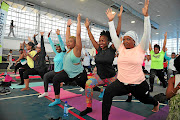 Female  athletes from different  parts of the country attend a  yoga session at   Klipspruit Sports Centre in Soweto in preparation for the Soweto Marathon to be held on November 3. / Veli Nhlapo