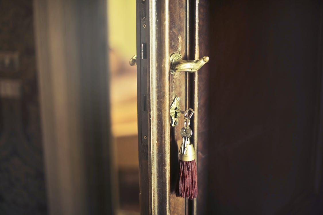 Key with trinket in shabby door