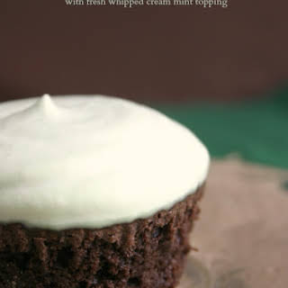 Fudgy Brownie Cupcakes with fresh whipped cream mint topping.