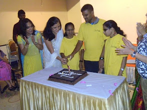 Photo: The cutting of the cake during the First Annual Celebration of our Sparsh Foot Spa